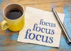 Focus concept - handwriting on a napkin with a cup of espresso coffee
